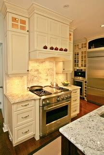 how to do kitchen cabinets stove top area traditional kitchen by interior works inc 7246