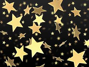 Golden stars on black background | PSDGraphics