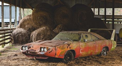 dodge charger daytona barn find heads  auction