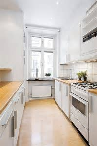 Photos of white galley kitchens