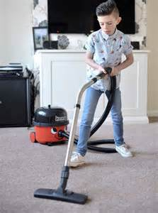 Boy who can't stop vacuuming: Rare condition Williams Syndrome means Lane Fountain loves helping