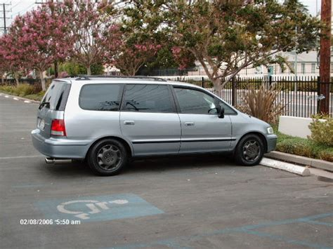 This new model replaced the swinging doors with a sliding door, increased the overall size of the frame and interior, increased the horsepower by adding a new v6 engine. dbrane22 1998 Honda Odyssey Specs, Photos, Modification ...