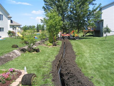 outdoor drainage systems advanced irrigation services creative outdoor lighting 440 232 6387