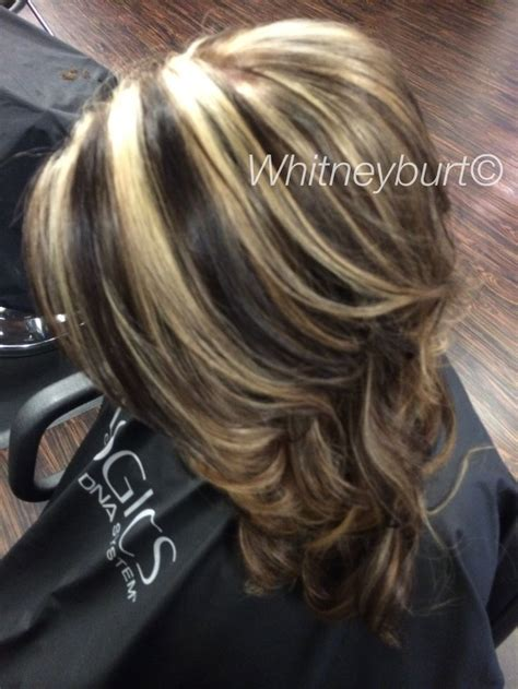 chocolate lowlights  bold blonde highlights