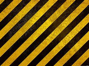 black and yellow caution stripes on metal texture