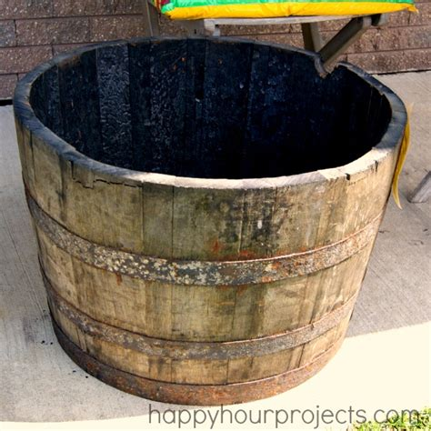whiskey barrel planter whiskey barrel planter project part one happy hour