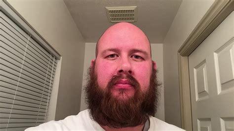 beard shaving my beard with a razor