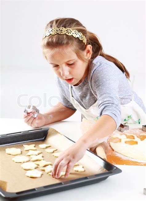 Cute girl baking cookies for Christmas   Stock Photo