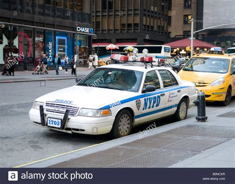 New York Police Car Parked At Fire Hydrant Stock Photo