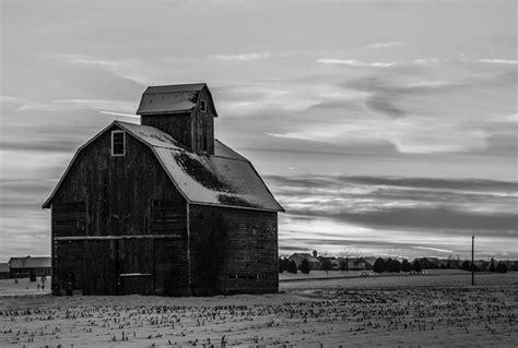 black and white barn black and white barn with a sunset photograph by jason borg