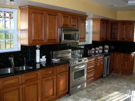 Restaining Oak Cabinets Forum golden oak kitchen cabinets with black countertops