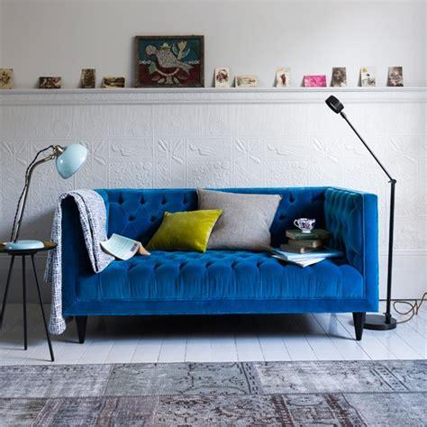 blue velvet sofa living room modern living room with blue velvet sofa and task lighting