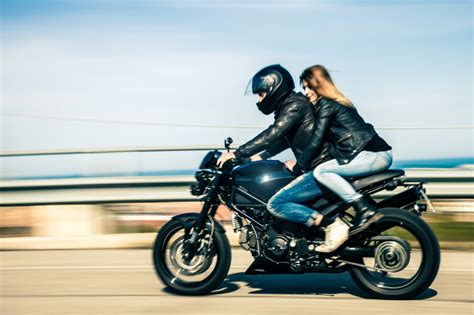 helmet laws affect cheap motorcycle insurance rates