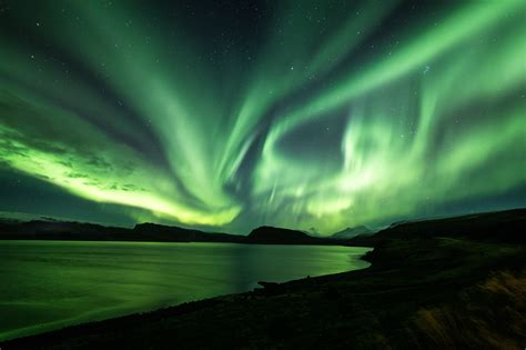 northern lights in iceland happy northern lights tour from reykjav 237 k guide to iceland