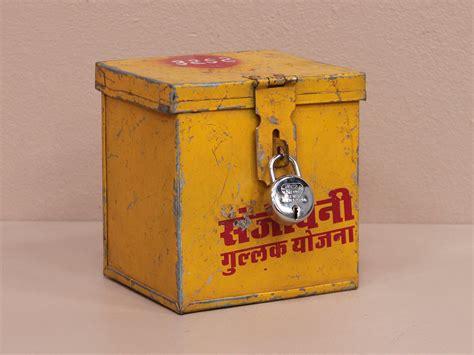 old yellow old yellow money box metal scaramanga