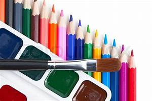 Watercolor Paints And Colored Pencils Isolated On A White