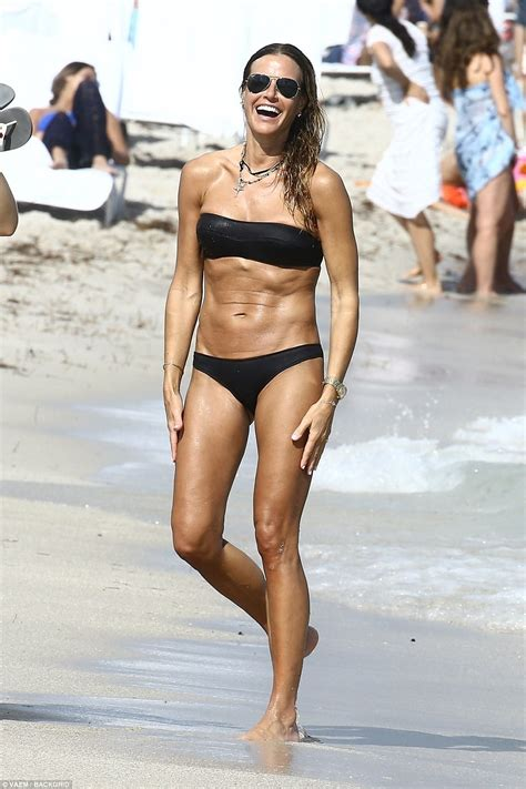 Kelly Bensimon appears nude in beige bikini in Miami ...