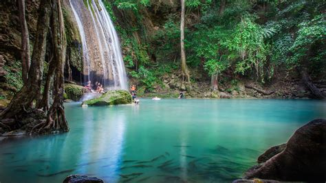 Summer Water Play By People In Erawan National Park