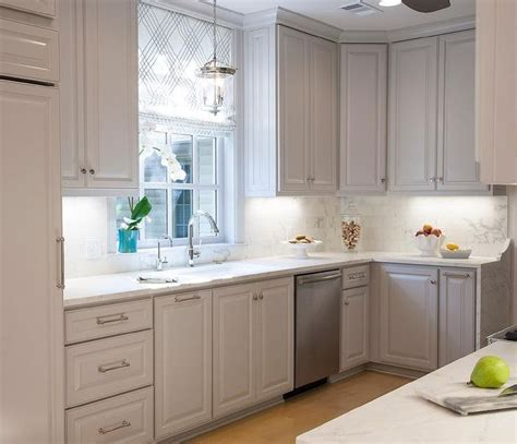 raised panel kitchen cabinets beautiful kitchen features light gray cabinets with raised 4488