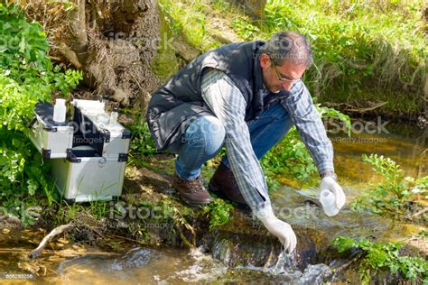 View Of A Biologist Take A Sample In A River Stock Photo ...