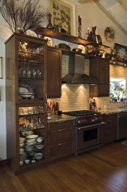 decorating ideas for above kitchen cabinets how to decorate the top of a cabinet and how not to