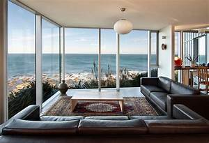 brown leather sofa glass walls ocean views cliff top With interior decor nz