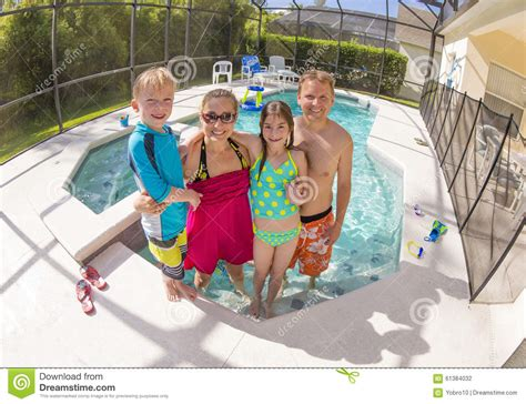 best pool size for family happy family playing in a backyard swimming pool stock photo image 61384032