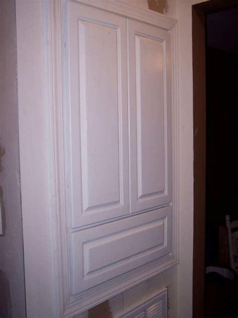 built in linen cabinet by mercerremodeling
