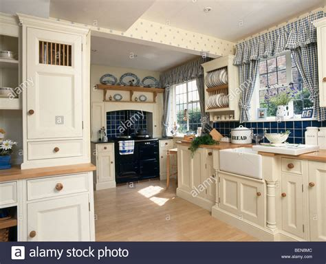 blue country kitchens blue checked curtains on window in country kitchen with 1724