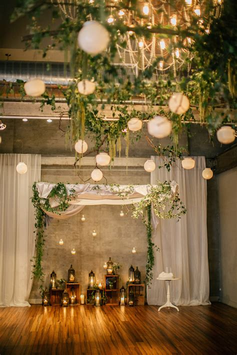a strand of greenery hung as decoration 10 ways to use greenery in your wedding decor and save money