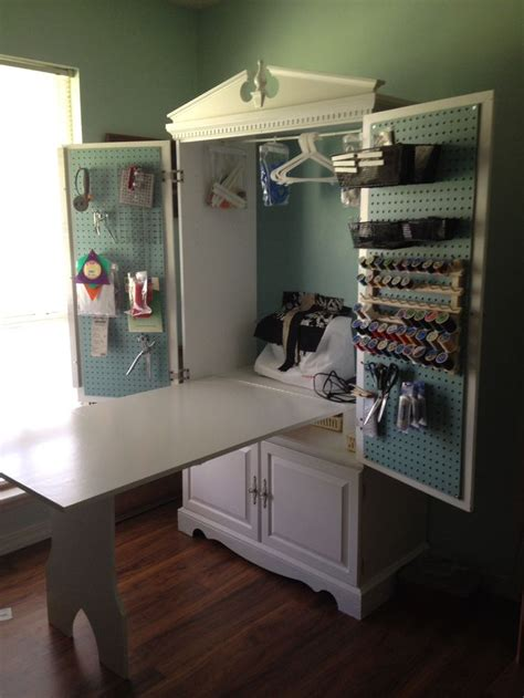 craft and main media cabinet tv armoire turned into a sewing cabinet with fold up table