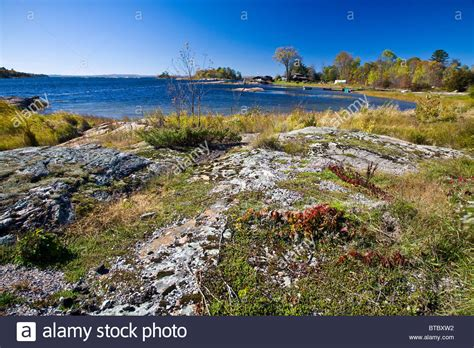 rocky shoreline and great landscape and cottage in