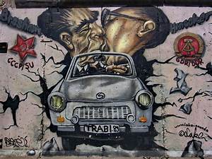Berlin wall art trabant famous brezhnev honecker kiss for Berlin wall art