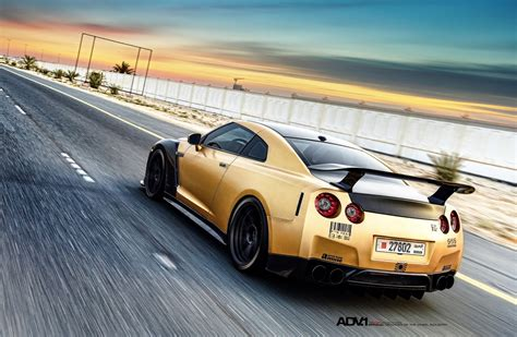 gold nissan car carbon gold nissan gt r looks beyond mean 33 pics