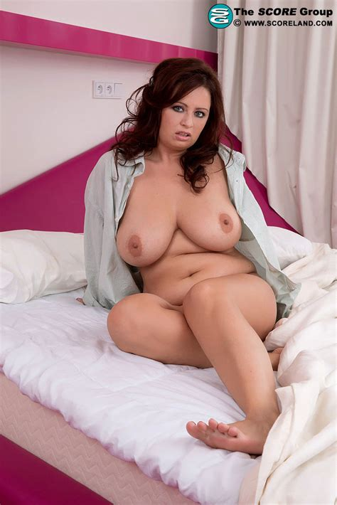 busty babe sirale showing her big boobs on a bed 1 of 2