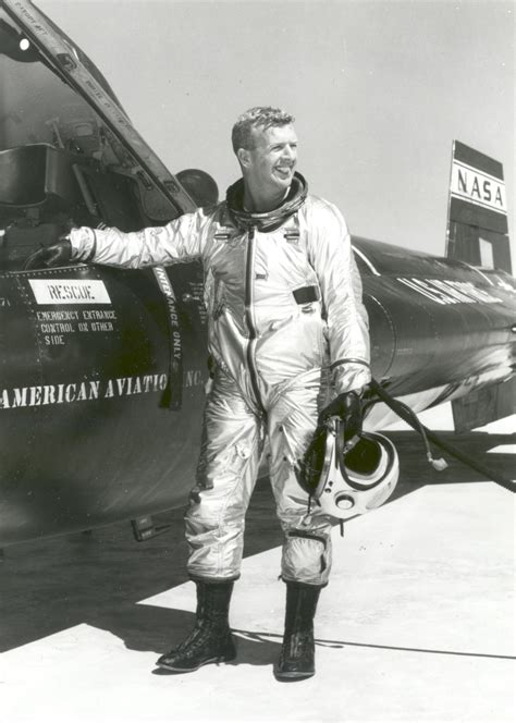 NASA test pilot Joe Walker beside an X-15 airplane ...