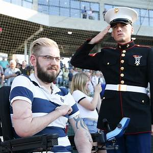 Marine Vet Throws Out First Pitch After Double Arm Transplant