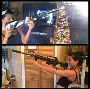 Americans pose by the Christmas tree with guns they got as ...