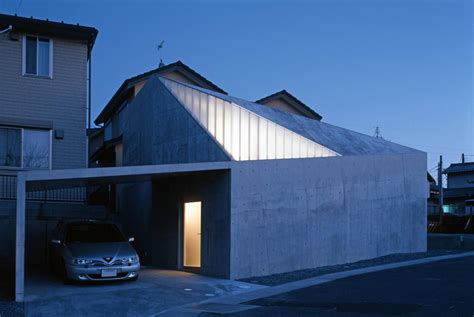 a house a home modern concrete house built on a budget and featuring an irregular shape