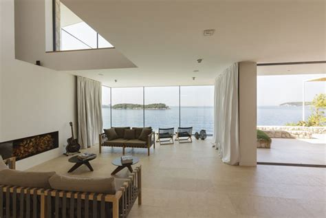 mediterranean house  large glass windows interiorzine