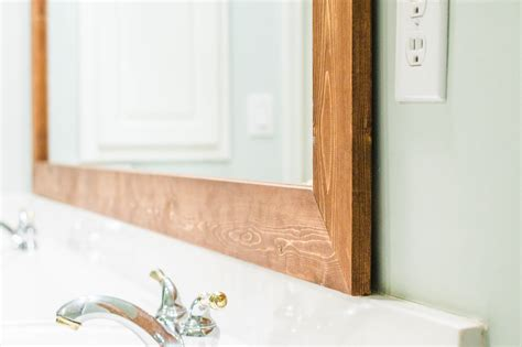 How To Frame A Bathroom Mirror With Wood how to diy upgrade your bathroom mirror with a stained