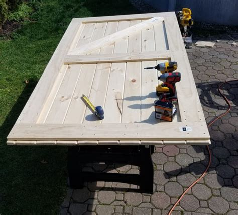 How To Frame A Barn Door by How To Build A Sliding Barn Door For Less The Honeycomb Home