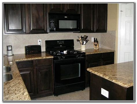 espresso kitchen cabinets with black appliances wood cabinets with black appliances odguinz home 9645