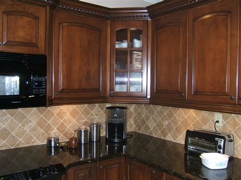 light colored oak cabinets with granite countertop   Here