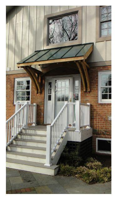 custom cedar brackets  metal roof front porch metal door awning house entrance porch