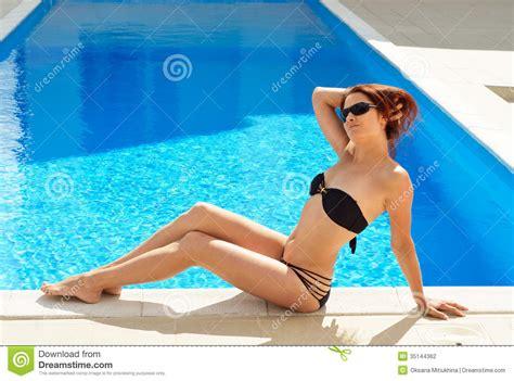 Woman Sunbathing Near The Sunlit Pool Stock Photo Image Of Sunbathing Water