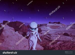 Futuristic Astronaut On Another Planet Mars Stock Photo ...