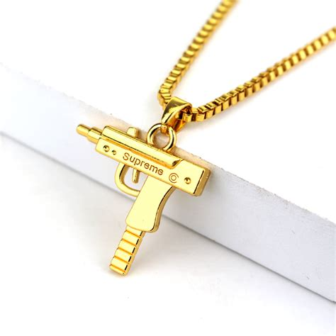 best deals on gold jewelry fashion hip hop jewelry engraved letter gun necklace 65cm