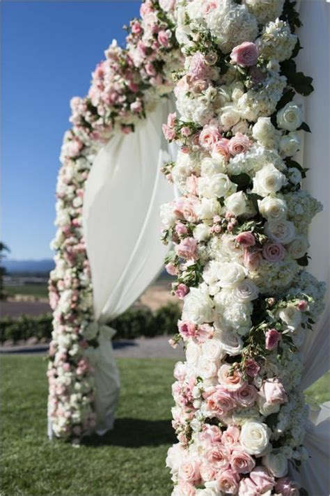stuning wedding arches  lots  flowers deer