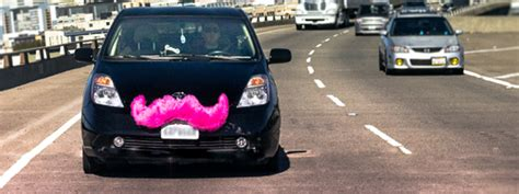 Lyft Uses Pink Mustache To Kiss Off Emissions